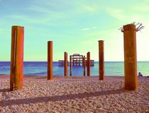 Artistic Brighton West Pier and pillars - blues. A really colourful modern art version of the view to Brightons West Pier from the beach in blues and aquas stock images