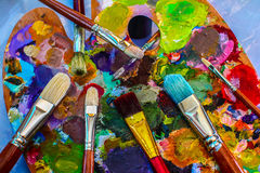 Artistic brushes and palette. The means of self-expression. Colorful world Stock Image