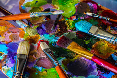 Artistic brushes and palette. Wonderful diverse world. Self-expression and artistic freedom Royalty Free Stock Image