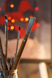 Artistic brushes in the workshop. Brushes artist on an abstract blurred background in the studio for artists. Royalty Free Stock Photos