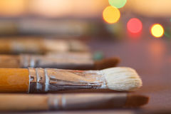 Artistic brushes in the workshop. Brushes artist on an abstract blurred background in the studio for artists. Stock Photography