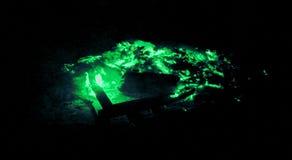 Artistic emerald green glowing embers stock photo