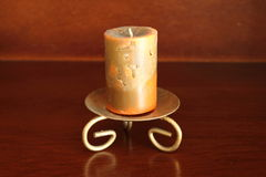 Artistic candle on a candleholder Stock Image