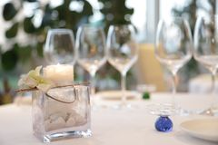 Centerpiece candle in an elegant restaurant for weddings. Artistic candle centerpiece in a elegant restaurant stock images