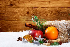 Artistic Christmas still life of fruit and spices Stock Photos