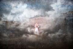 Artistic cityscape with blonde woman royalty free stock photos