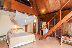Artistic and Clean Bedroom Villa With Bataknese Style Room Royalty Free Stock Photography