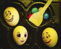 Artistic close-up composition of funny egg family underyellow light feeling for christmas and easter royalty free stock photos