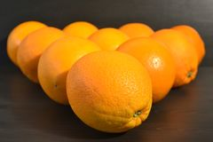 Composition of a group of ripe oranges in a shape of a triangle. royalty free stock photo