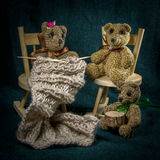 Artistic compositions with knitted animals. Bears knit stock images