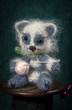 Artistic compositions with knitted animals. Royalty Free Stock Images