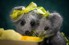 Artistic compositions with knitted animals. Mouse and cheese stock photography