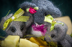 Artistic compositions with knitted animals. Mouse and cheese stock photo