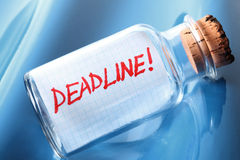 An artistic concept of a message in a bottle deadline. An artistic concept of a message in a bottle saying deadline Royalty Free Stock Images