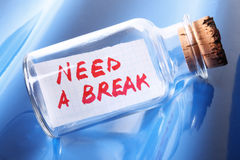 An artistic concept of a vintage bottle saying Need a break Stock Photo