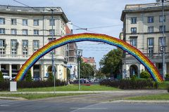 An artistic construction of rainbow on Savior Square in Warsaw. Rainbow made of artificial flowers has been vandalized several times due to identification with Royalty Free Stock Image