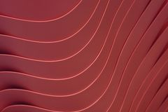 Artistic curved lines of the piled up maroon color plastic bowls, for background. Artistic curved lines of the piled up maroon color plastic bowls, for pattern royalty free stock photography