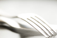 Artistic cutlery fork and knife macro on plate Royalty Free Stock Photo