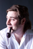 Young  man smoking a pipe Stock Photography