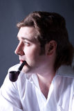 Artistic dark portrait l man smoking a pipe Royalty Free Stock Photography