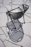 Artistic Design Study of Wrought Iron Chair and Fl Stock Photography