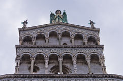 Artistic details on a facade of Lucca cathedral, Tuscany Stock Photo