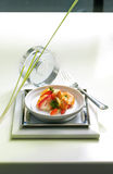 Artistic display of food. A well composed food shot comprising of colorful food items in a bowl placed on a tray with a glass cover and a fork on either side and Royalty Free Stock Photography