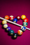 Pool Billiard Balls in a heart shape on Red felt table Royalty Free Stock Photos