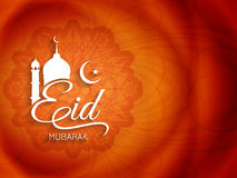 Artistic Eid Mubarak text design background royalty free illustration