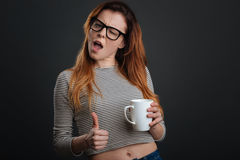 Artistic energetic girl enjoying her coffee royalty free stock images