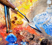 Artistic equipment. Paint, brushes, spatula and art palette royalty free stock photography