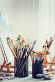 Artistic equipment in studio of painter. Royalty Free Stock Photos