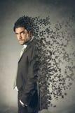 Artistic erosion effect on businessman Stock Photo