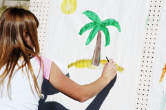 Artistic expression 3. Child showing her artistic abilities during a street fair Royalty Free Stock Images