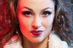 Artistic fashion portrait of beautiful woman red and blue lights Stock Photos