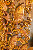 Artistic fish. Wood carving patterns on the fish Royalty Free Stock Image