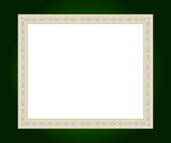Artistic frame. Artistic golden frame on green background with white copy space Royalty Free Stock Images