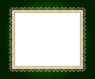Artistic frame. Artistic golden frame on green background with white copy space Stock Image