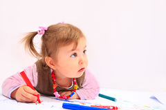 Artistic girl. Little girl is drawing with colour markers on white background Royalty Free Stock Photography