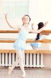 Artistic girl posing at camera in ballet class Stock Photos