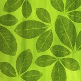 Artistic green background with pencil-shaped leaves. Illustration pattern with green leaves hand drawn on acid green background Royalty Free Stock Image
