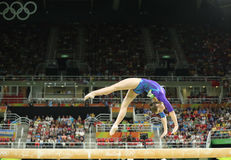 Artistic gymnast Aliya Mustafina of Russian Federation competes on the balance beam at women`s all-around gymnastics at Rio 2016 Royalty Free Stock Photos