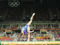 Artistic gymnast Aliya Mustafina of Russian Federation competes on the balance beam at women`s all-around gymnastics at Rio 2016 Stock Photos
