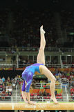 Artistic gymnast Aliya Mustafina of Russian Federation competes on the balance beam at women`s all-around gymnastics at Rio 2016 Stock Images