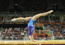 Artistic gymnast Aliya Mustafina of Russian Federation competes on the balance beam at women`s all-around gymnastics at Rio 2016. RIO DE JANEIRO, BRAZIL - AUGUST Royalty Free Stock Images