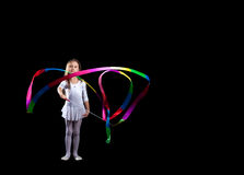 Artistic gymnast dancing with colorful ribbon Royalty Free Stock Photography