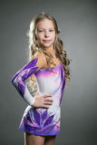 Artistic gymnast posing in dress for performances Royalty Free Stock Images