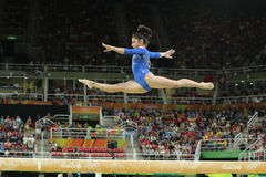 Artistic gymnast Seda Tutkhalyan of Russian Federation competes on the balance beam at women`s all-around gymnastics at Rio 2016. RIO DE JANEIRO, BRAZIL - AUGUST Stock Photos
