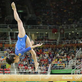 Artistic gymnast Seda Tutkhalyan of Russian Federation competes on the balance beam at women`s all-around gymnastics at Rio 2016. RIO DE JANEIRO, BRAZIL - AUGUST Royalty Free Stock Images