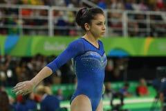 Artistic gymnast Seda Tutkhalyan of Russian Federation competes on the balance beam at women`s all-around gymnastics at Rio 2016. RIO DE JANEIRO, BRAZIL - AUGUST Stock Photography